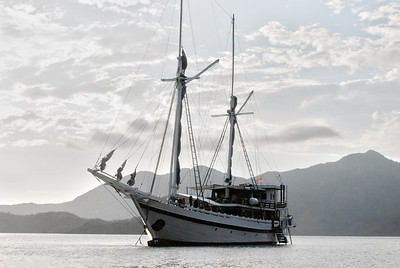 The M/V Komodo Dancer sits at anchor in Horseshoe Bay off Rinca Island in the Komodo National Park, Indonesia.