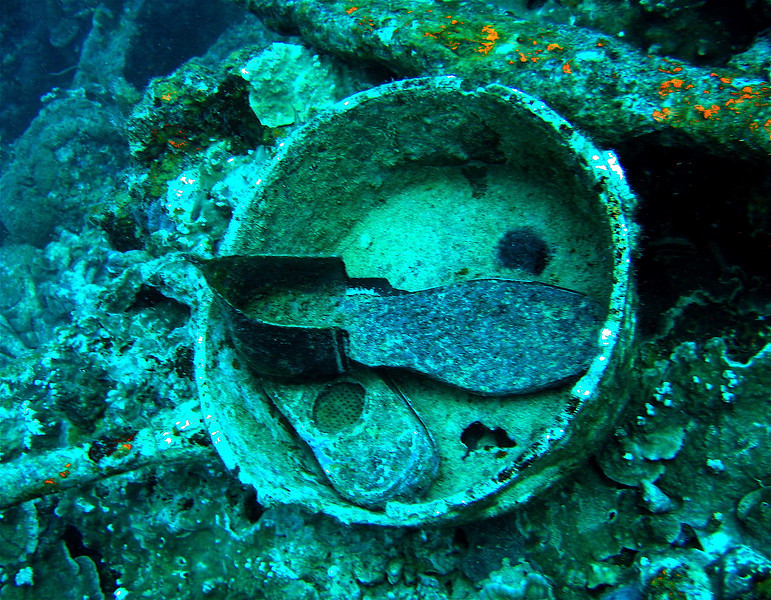 "A pot, the sole of a shoe...found on the World War II Japanese shipwreck named ""Helmet"". Palau."