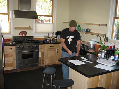 our model jacob cooking some imaginary food in this amazing kitchen.