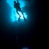 Divers exploring Blue Hole - Palau