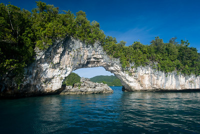 This natural arch is a signature site in the Rock Islands of Palau.