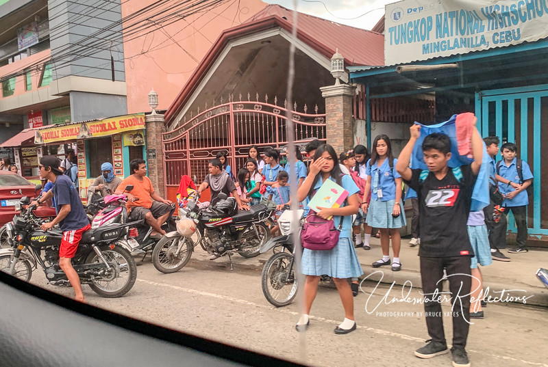 Following are some photos taken while driving from Acqua Dive back to Cebu to catch the Siren. High school students getting out of school.