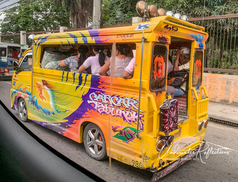 "This is a ""Jeepney"", essentially small busses that are highly customized and flashy, and usually jam-packed with people."