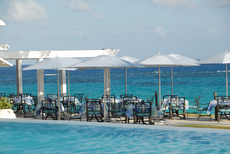 Outdoor dining overlooking the ocean at the Tuckers Point Beach Club, Bermuda
