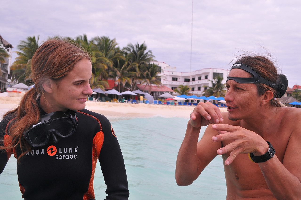 Jordan Coyne (left) listening to dive briefing from Enrique Rodriguez (right) from Playa Scuba Dive Center.