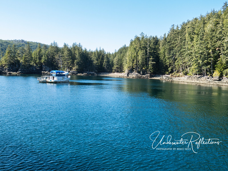 """The cove where we usually anchored at night.  This is the only other liveaboard dive boat operating these waters, and it appears to be pretty """"bare bones"""" (e.g., guests must bring their own food with them!)."""