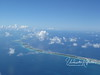 An atoll is the ring of coral/lava that remains where the rim of a volcano once rose from the ocean.  This is part of the Rangiroa atoll as seen from the air.