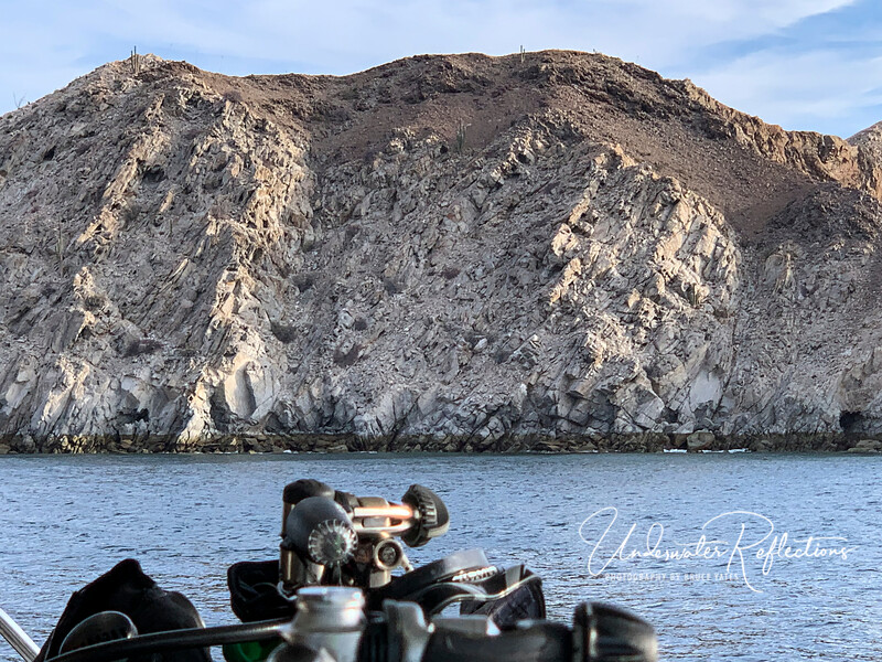 Most of our diving was done along islands and shorelines like this.  Note that cacti growing along the ridge.