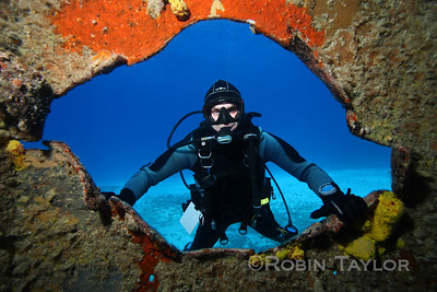 Yours truly, photographed by Lee through the torpedo hole.  This is one of the classic photos we shoot of the guests at Finphoto.