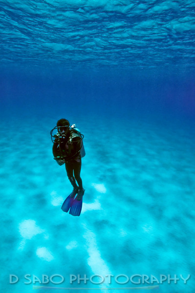 """Hanging Out""  My Cozumel divemaster illustrating perfect neutral buoyancy during his safety stop after a deep dive."