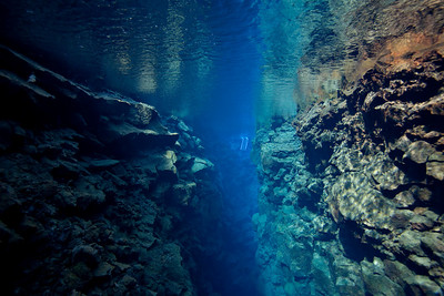 Although Silfra has numerous caves over 60 meters deep, the depth is usually from 1 to roughly 30 meters.