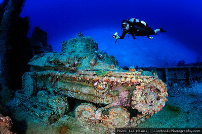 A diver hovers over a sunken tank on the Nippo Maru, a Japanese World War II wreck. Truk Lagoon, Chuuk, Micronesia