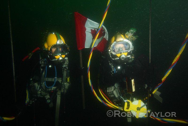 Class flag and rum being proudly presented at depth