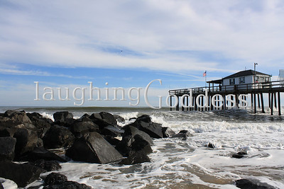 Ocean Grove Fishing Club stands above the rocky coast on a sunny Sunday afternoon. Sadly, the structure did not survive the ravages of Hurricane Sandy and no longer stands on the Ocean Grove coast.