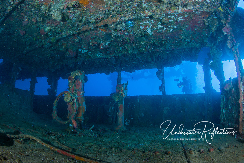 Interior of an old wheelhouse.  You can almost imagine a captain and crew standing here surveying the wide open seas ahead.