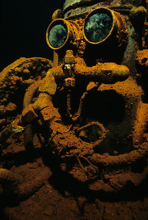 Nicknamed R2D2 for the infamous little robot of Star Wars, a compressor sits idly by the entrance to the machine shop of the Fujikawa Maru.