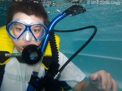Josh Lakes, 12, practices scuba diving during a class for local Boy Scouts at Clifton Diving Ventures in Sycamore on Sunday, June 24, 2010.