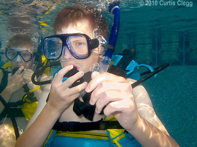 Zachary Salapatek, 16, practices breathing underwater during scuba diving class at Clifton Diving Center in Sycamore on Thursday, June 10, 2010.