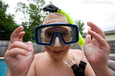 Jack Daurer, 11, of Genoa adjusts his diving mask during a lesson on proper snorkeling techniques at Clifton Diving Center in Sycamore on Thursday, June 10, 2010.  Once Daurer gets his scuba certification, he plans to go to Mexico with his parents, who are also certified divers.