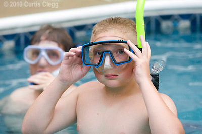 Jack Daurer, 11, of Genoa (right) adjusts his diving mask during a lesson on proper snorkeling techniques at Clifton Diving Center in Sycamore on Thursday, June 10, 2010.  Once Daurer gets his scuba certification, he plans to go to Mexico with his parents, who are also certified divers.