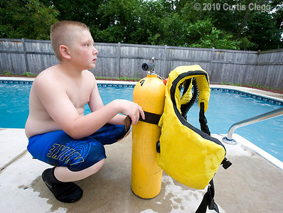 Jack Daurer, 11, of Genoa gets familiar with scuba diving equipment during a class at Clifton Diving Center in Sycamore on Thursday, June 10, 2010.  Once Daurer gets his scuba certification, he plans to go to Mexico with his parents, who are also certified divers.