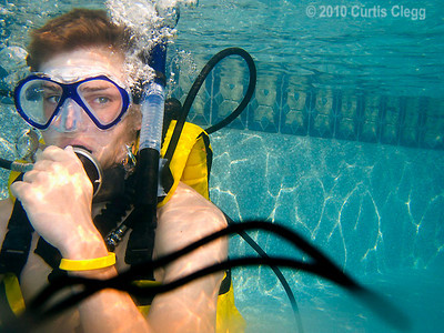 Justin Vitkus, 16, practices scuba diving during a class for local Boy Scouts at Clifton Diving Ventures in Sycamore on Sunday, June 24, 2010.