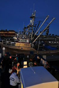 Predawn boarding and gear assembly in preparation for a day of diving in the Channel Islands.