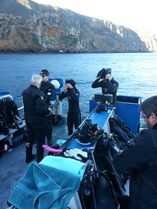 Divers preparing their gear on board the Spectre.