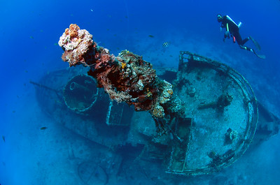 A rebreather diver floats without making bubbles over the wreck of El Limon in La Caletta National  Marine Park near Santo Domingo, Dominican Republic.
