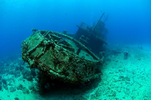 A closed circuit rebreather diver parks himself beside the wreck of El Limon in La Caletta National Marine Park near Santo Domingo, Dominican Republic. Photo: Jill Heinerth