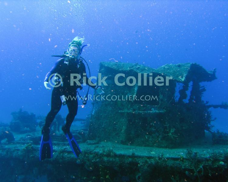 "A diver waits for her dive buddy near a sunken tugboat.  St. Eustatius (Statia), Netherlands Antilles.<br /> <br /> <br /> <br /> <br /> ""St. Eustatius"" ""Saint Eustatius"" Statia Netherlands Antilles ""Lesser Antilles"" Caribbean underwater diving ocean SCUBA dive diver wreck sunken boat"