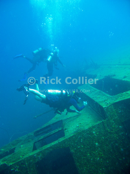 "Diving Bonaire, Netherland Antilles -- Divers explore the wreck of the Hilma Hooker.  (""Hilma Hooker"" dive site)  © Rick Collier<br /> <br /> <br /> <br /> <br /> Bonaire; ""Netherlands Antilles""; Caribbean; tropic; tropical; vacation; destination; scuba; diving; dive; ""scuba diving""; wreck; ""Hilma Hooker""; diver; divers; photography; ""taking pictures""; ""ship wreck""; shipwreck;"