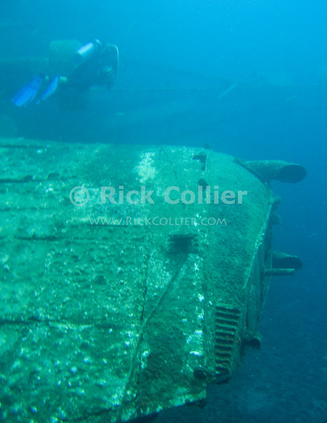 St. Eustatius (Statia) Underwater - Divemaster Remco leads a group of scuba divers over the funnel of the Charlie Brown shipwreck.  (The MV Charles D. Brown was an ATT cable-laying ship until it was purposely sunken in 1983 as a dive site.)  © Rick Collier