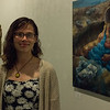Amber Berg, graduate student in regional and community planning poses by student exhibits in the Unearthed: Art of and From the Earth project in the William T. Kemper Art Gallery (Conrad Kabus | Collegian Media Group)