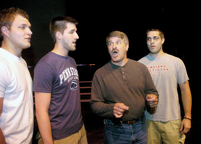 "Adam, Jeff, Ken and Brain Paulhamus, of the barbershop quartet, ""Achording To Dad,"" rehearse for 2012: Barbershop Odyssey.  The show is on Saturday the 12th at 7:30 p.m. inside the Weis Center at Bucknell, tickets can be purchased at the door."