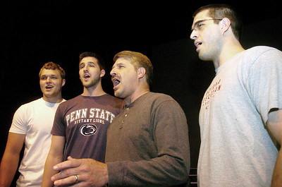 "Brian, Ken, Jeff and Adam Paulhamus, of the barbershop quartet, ""Achording To Dad,"" rehearse for 2012: Barbershop Odyssey.  The show is on Saturday the 12th at 7:30 p.m. inside the Weis Center at Bucknell, tickets can be purchased at the door."