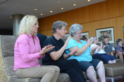 Cindy Arbogast-Royer, left, along with Eva Hurliman, Beavertown, and Julianna Csoka Cooper, Lewisburg, attempt the hand rhythms used in a  Ragamala Dance during a lecture on Wednesday at Bucknell with performing artist Aparna Ramaswamy.
