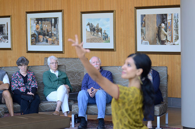 Jan Pearson, left, Lewisburg, watches with Dorris Keen, Lewisburg, and David Pearson, Lewisburg, Aparna Ramaswamy perform a section of a  Ragamala Dance on Wednesday at Bucknell during a lecture.