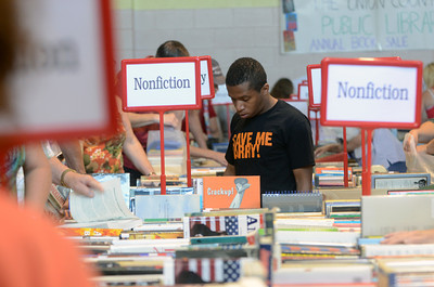 Josiah Farnsworth, Penns Creek, glances at a table full of books Wednesday morning at the Union County library's book sale at the Faith Lutheran church in Lewisburg.