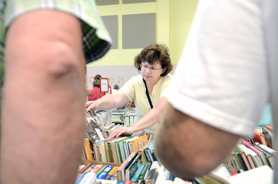 Mary Boudman, Millville, searches through the selection of craft books for sale at the Union County library book sale Wednesday morning at the Faith Lutheran church in Lewisburg.