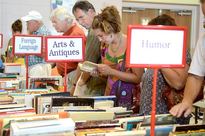 Hundreds of people search through thousands of books Wednesday morning at the Union County library book sale at the Faith Lutheran church in Lewisburg.