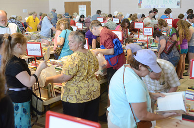 Hundreds of people scour the books for sale on Wednesday morning at the Union County library's book sale at the Faith Lutheran church in Lewisburg.