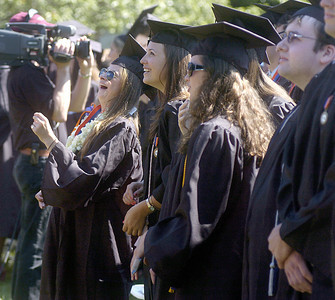 Bucknell graduates laugh during the commencement ceremony on Sunday.