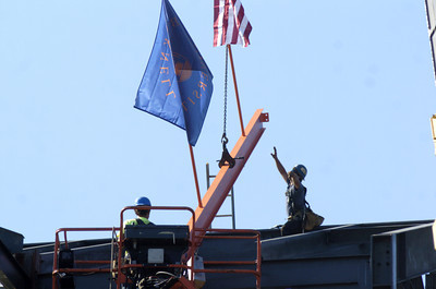 A steel beam is put in place on the new Academic West building still under construction at Bucknell University, during their topping out ceremony on Thursday.