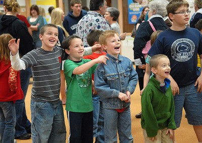 Alec Troester, 8, Corbyn Katz, 8, Brett Swank, 8, Danny Bilger, 6, and Jacob Troester, 9, react to seeing themselves in the photo slideshow during the open house at Buffalo Crossroad Elementary School Thursday May 10, 2012.