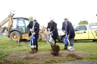 Ronald P. Dreese, left, Bishop Robert Driesen, and Gary Baylor, help to break ground for the new nursing care center.