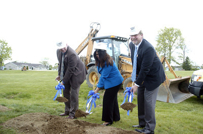 Steven L. Daniels, R.A., left, Tama Carey, and Mark T. Pile, help break ground for the new nursing care center.