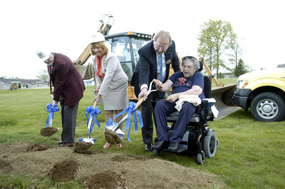 Fred Bigelow, left, Resident Advisory Committee at Buffalo Valley Lutheran Village, and Lennea Brown, Executive Director of the Buffalo Valley Lutheran Village, break ground next to Mark T. Pile, President and CEO of Diakon Lutheran Social Ministries who helps Jane Troutman, President of the Buffalo Valley Nursing Care Center Residential Council, on Tuesday during a ground breaking ceremony for the Buffalo Valley Lutheran Village's new nursing care center project.