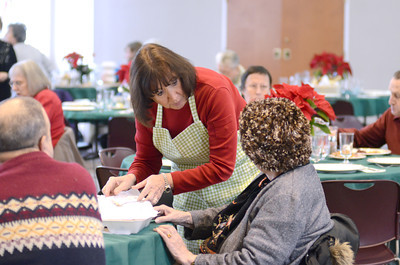 Judy Lebda, left, Lewisburg, helps Mildred Klove of Milton get a desert at the community Christmas dinner on Wednesday at the First Presbyterian Church in Lewisburg.