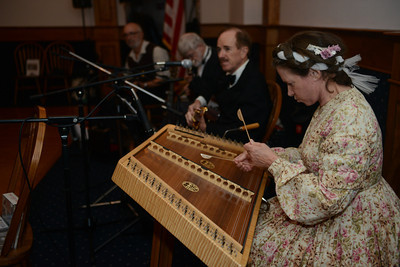 Musicians play for dancers at the civil war ball.